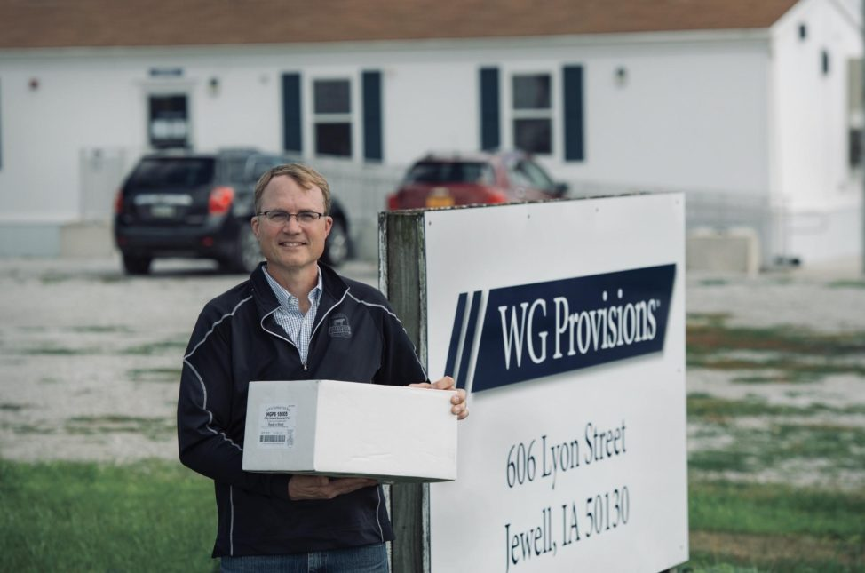 WG Provision Employee standing outside sign